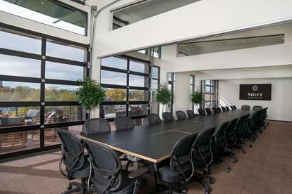 Boardroom Style seating on the top floor Conference Area. One of several configurations.
